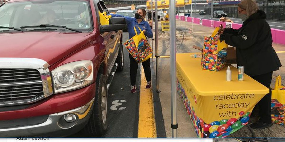 Cars circle track for candy at Charlotte Motor Speedway's Track 'n Treat