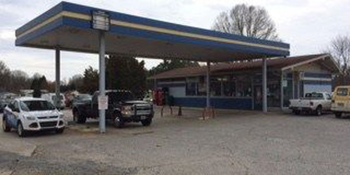 State files suit, condemns mechanic shop on Highway 52