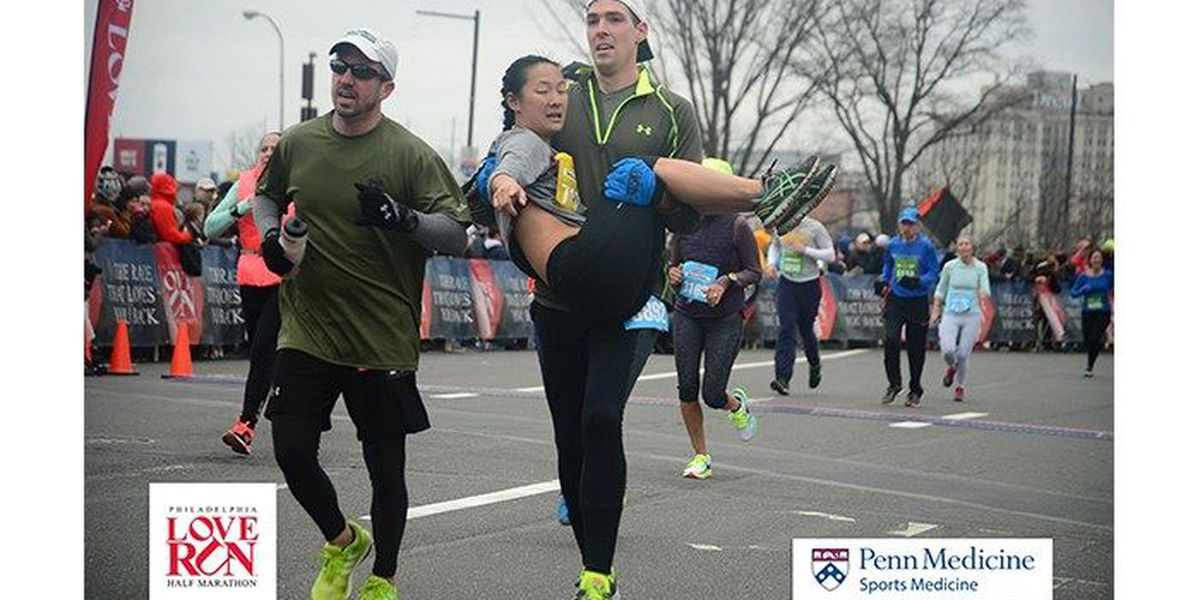 VIDEO: Runner carries woman to finish line, helps her finish marathon