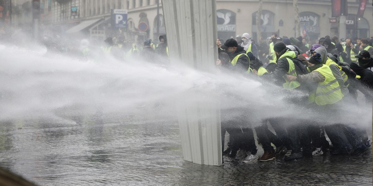 The Latest: Macron condemns violence at French protests