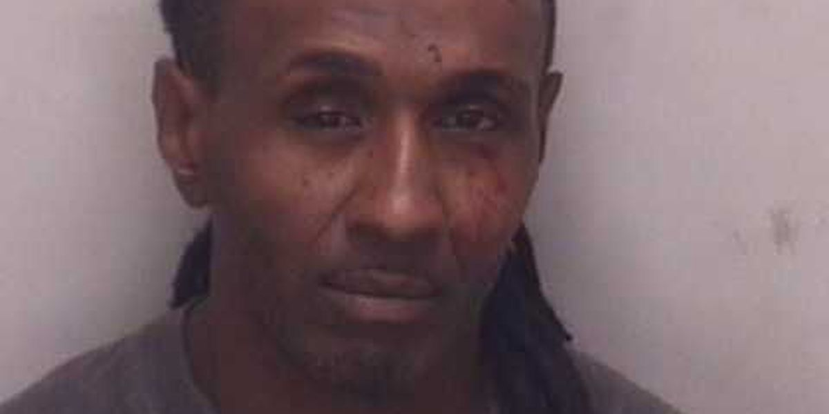 Man charged for pulling gun on customer at gas station