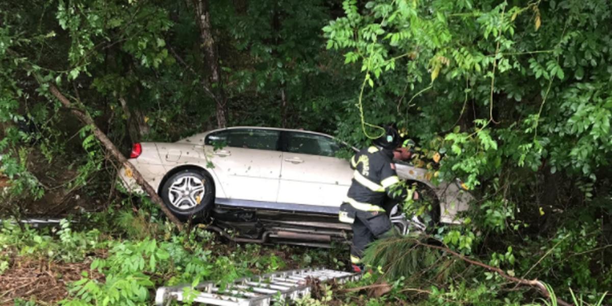 Car crashes down 15-foot embankment in Harrisburg