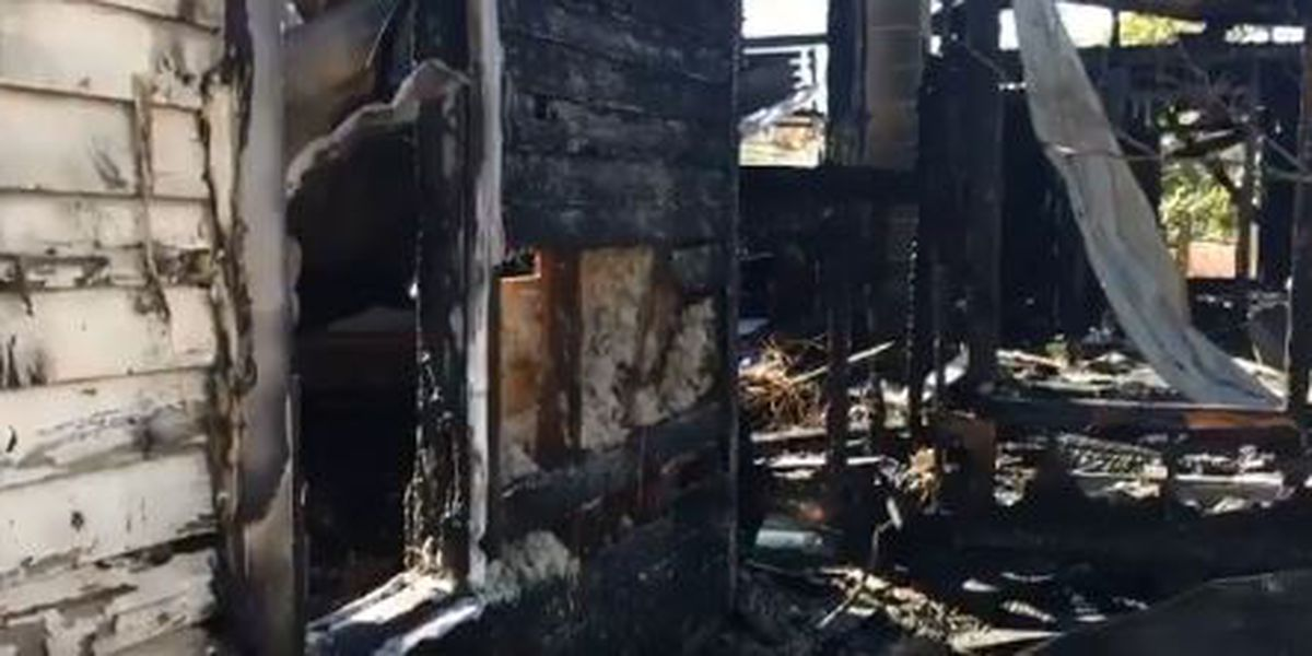 Dramatic video shows firefighters entering burning home