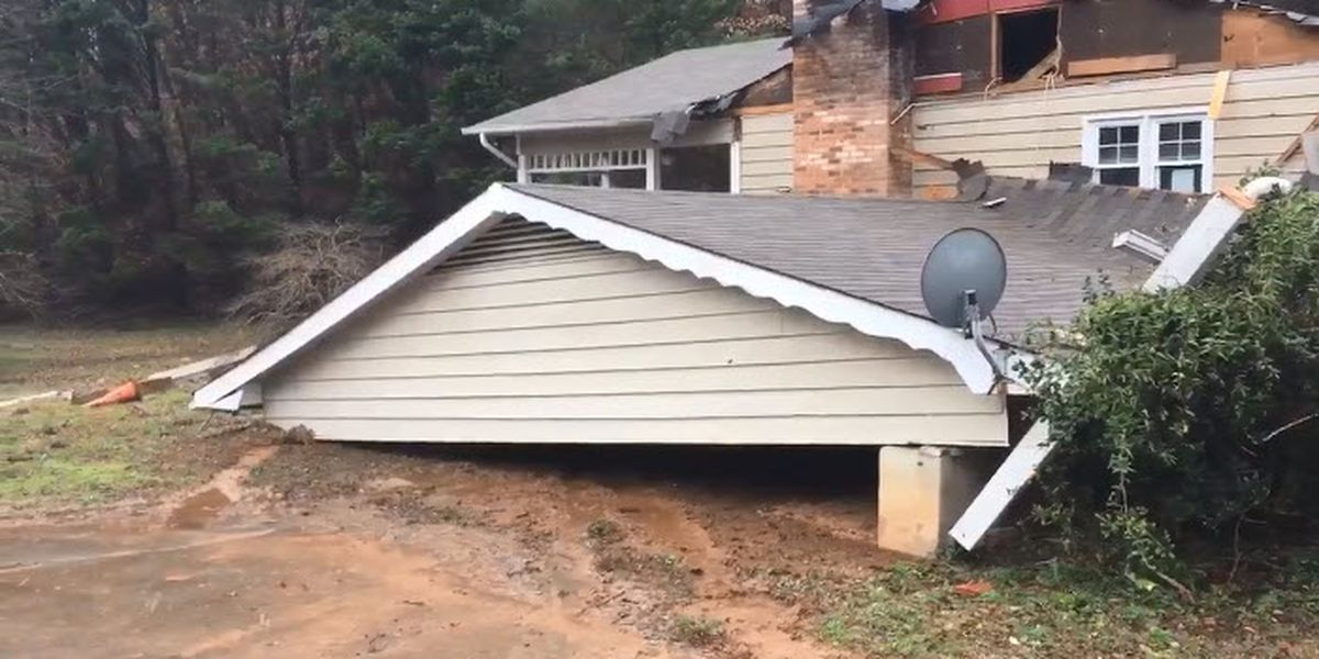 Car chase ends when driver crashes into home, causing collapse