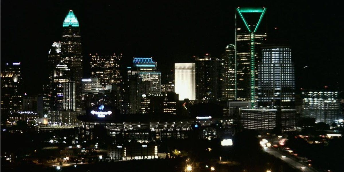 #CharlotteStrong: City skyline lights up green to honor victims of deadly UNC Charlotte shooting