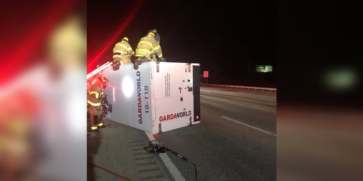Armored truck flips over on highway in Rowan County