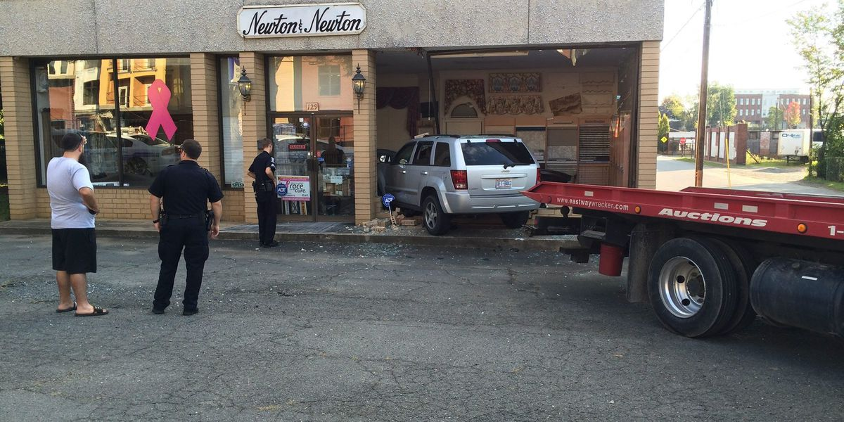 Car slams into Charlotte storefront