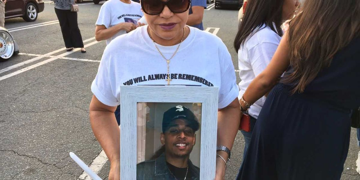 Candlelight vigil held for 2017's first homicide victim