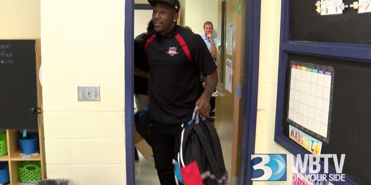 Carolina Panther Thomas Davis distributes 700+ backpacks at elementary school