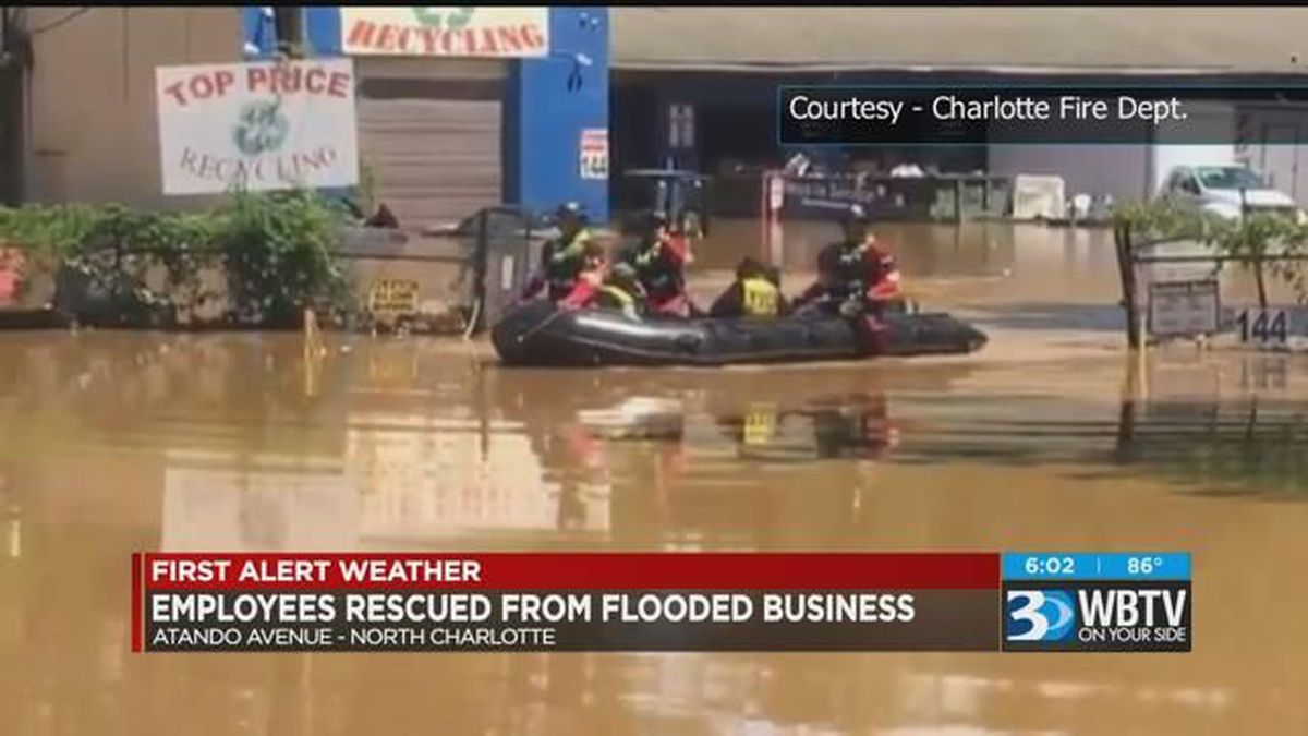 employees rescued from flooded business