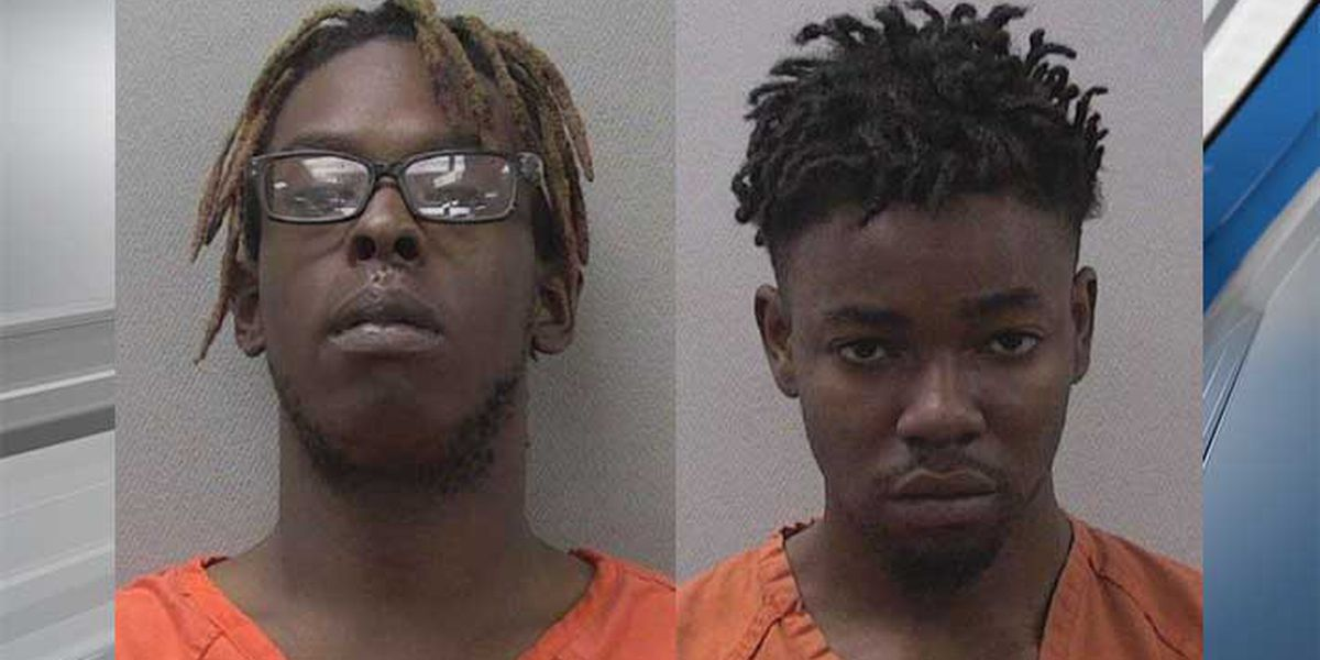 2 men charged with shooting woman in head during robbery