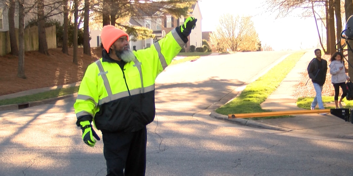 Highland Creek crossing guard spreads smiles and safety