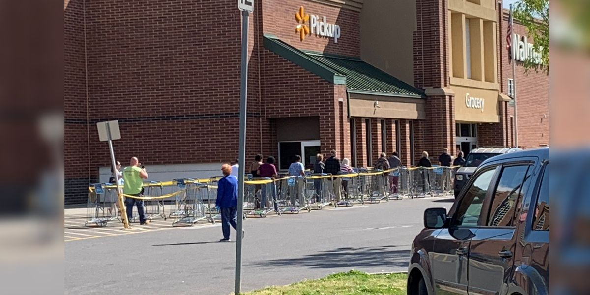 Dozens line up outside Walmart as store limits shoppers