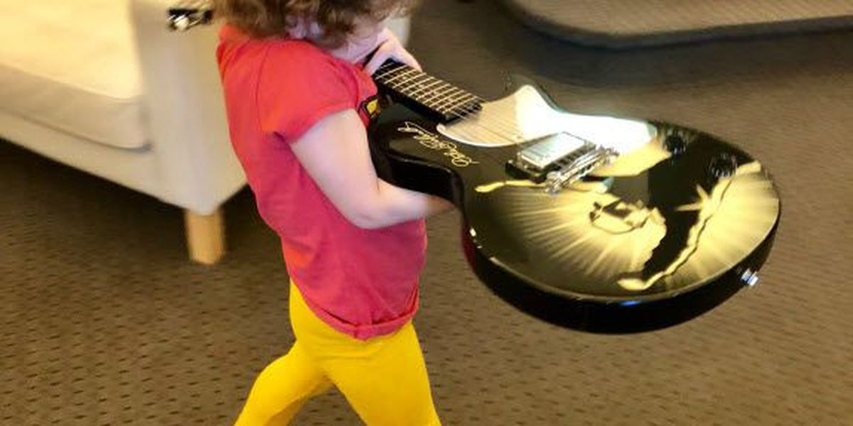 Molly's Kids: Guitar signed by Dale Earnhardt donated to 4-year-old who finished chemo